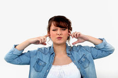Woman blocking her ears Royalty Free Stock Photo