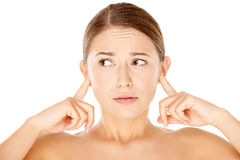 Woman blocking her ears with her fingers Royalty Free Stock Image