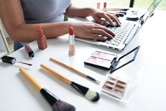 Free Woman Blogger Present Cosmetic Product Sitting In Front Tablet And Broadcast To Social Network By Internet, Beauty Blogger Online Stock Images - 154201334