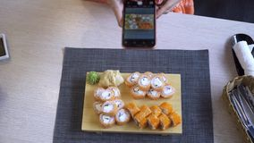 A woman blogger takes photo of food on a phone, for social networks, a view from the top. A woman blogger takes photo of food on a phone, for social networks, a stock video footage