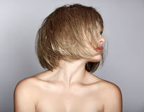 Woman with blond bob. Portrait of a beautiful woman in short blond bob with messy wet hair on studio background Stock Photos