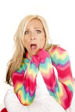 Woman blond color pajamas pillow sit scared Stock Image