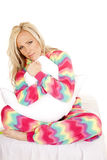 Woman blond color pajamas pillow sit smile Royalty Free Stock Photography