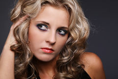 Woman with blond curly hair. Stock Image