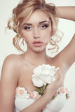 Woman with blond curly hair and evening makeup,wears flowers lingerie Stock Images
