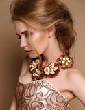 Woman with blond hair and bright makeup with luxurious necklace Royalty Free Stock Image