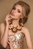 Woman with blond hair and bright makeup with luxurious necklace Stock Image