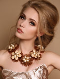 Woman with blond hair and bright makeup with luxurious necklace Stock Photo