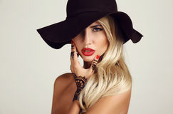 Woman with blond hair with evening makeup and henna tattoo on hands Stock Photography