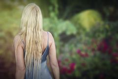 Blond woman in front of a smooth background Royalty Free Stock Image