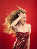 Woman with blond hair and red dress. Screams stock photography