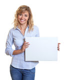 Woman with blond hair showing a white board Royalty Free Stock Photo