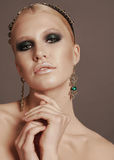 Woman with blond hair and smokey eyes makeup,with bijou and headband Royalty Free Stock Images