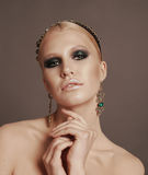 Woman with blond hair and smokey eyes makeup,with bijou and headband. Fashion photo of glamour beautiful woman with blond hair and smokey eyes makeup,with bijou Royalty Free Stock Images