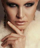 Woman with blond hair and smokey eyes makeup,wears luxurious fur coat. Fashion photo of glamour beautiful woman with blond hair and smokey eyes makeup,wears Royalty Free Stock Photo