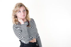 Woman with blond hair on white wearing striped shirt stock photography