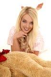 Woman blond pajamas bear lay forward feet up Stock Photos