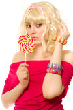 Woman in blond wig with lollipop Royalty Free Stock Images