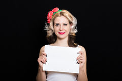 Woman with blonde curls and red lipstick at the rim with red flowers holding Stock Photos