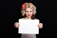 Woman with blonde curls and red lipstick at the rim with red flowers holding Royalty Free Stock Photo