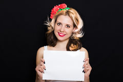 Woman with blonde curls and red lipstick at the rim with red flowers holding Stock Photography