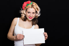 Woman with blonde curls and red lipstick at the rim with red flowers holding Stock Images