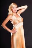 Woman blonde fashion model in yellow dress Stock Photos