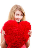 Woman blonde girl holding red heart love symbol. Woman blonde long hair girl holding red big heart love symbol studio shot isolated on white. Valentines day royalty free stock photography