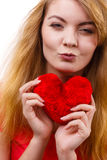 Woman blonde girl holding red heart love symbol Royalty Free Stock Image