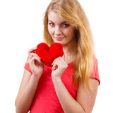 Woman blonde girl holding red heart love symbol. Woman blonde long hair girl holding red heart love symbol studio shot isolated on white. Valentines day royalty free stock image