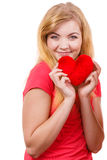 Woman blonde girl holding red heart love symbol. Woman blonde long hair girl holding red heart love symbol studio shot isolated on white. Valentines day royalty free stock photography