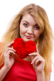 Woman blonde girl holding red heart love symbol. Woman blonde long hair girl holding red heart love symbol studio shot isolated on white. Valentines day stock image