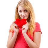Woman blonde girl holding red heart love symbol. Woman blonde long hair girl holding red heart love symbol studio shot isolated on white. Valentines day royalty free stock images