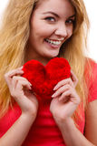 Woman blonde girl holding red heart love symbol. Woman blonde long hair girl holding red heart love symbol studio shot isolated on white. Valentines day royalty free stock photos