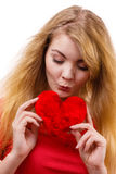 Woman blonde girl holding red heart love symbol Royalty Free Stock Images