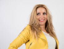 Sofia, my best model in photographic studio. Woman with blonde hair and blue eyes with yellow jacket, poses in photographic studio with white background Stock Images
