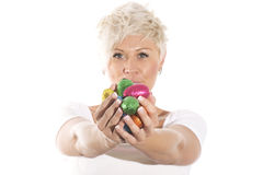 Woman with blonde hair holding chocolate bunny easter egg. Stock Photo