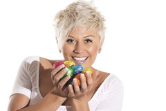 Woman with blonde hair holding chocolate bunny easter egg. Stock Photos