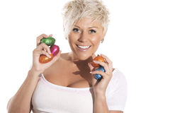 Woman with blonde hair holding chocolate bunny easter egg. Royalty Free Stock Photos