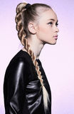Woman with blonde hair plait in profile Royalty Free Stock Images