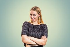 Woman with blonde hair smiling flirty royalty free stock image
