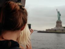 Woman Blonde Hair Taking Picture of Statue of Liberty Stock Photos