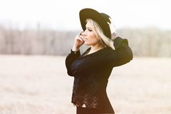 Woman With Blonde Hair Wearing Black Hat and Black Long Sleeve Shirt Royalty Free Stock Photography