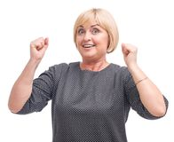 Woman, blonde, isolated on white background, smiling, clasped hands, in a fist. Royalty Free Stock Image