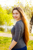 Woman with blonde long hair in nature Royalty Free Stock Images