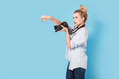 Woman blonde photographer shows how to pose Stock Image