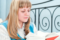 Woman blonde reading book royalty free stock photos