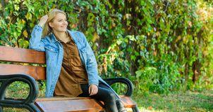 Woman blonde take break relaxing in park. You deserve break for relax. Ways to give yourself break and enjoy leisure. Girl sit bench relaxing fall nature stock photography