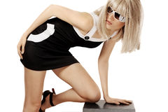 Woman in blonde wig and sunglasses stock images