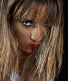 Woman with bloody lips Stock Photos